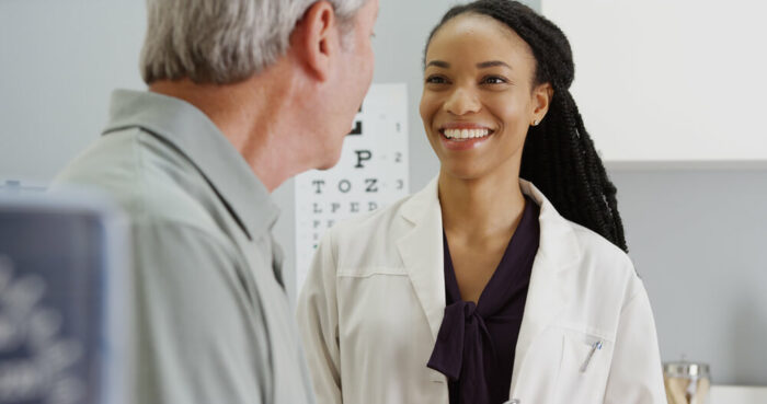 Doctor talking to a patient after eye exam