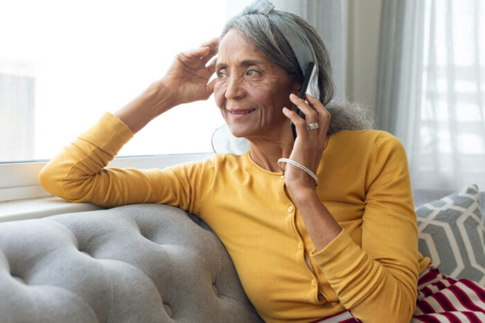 Older woman on the phone and looking out the window