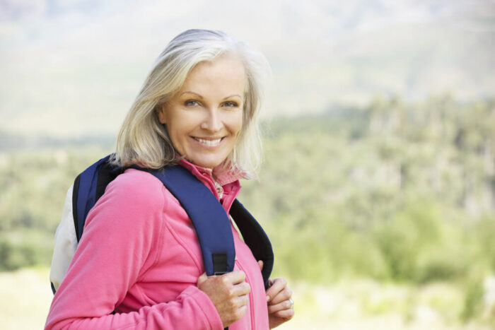 Mature woman hiking with backpack
