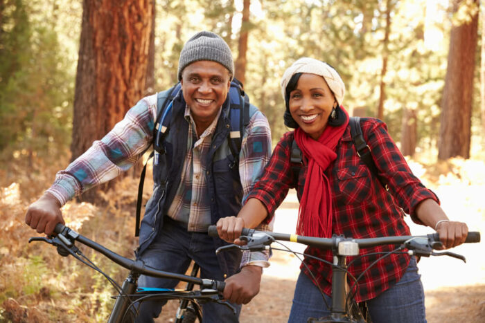 Mature couple riding their bikes in the woods